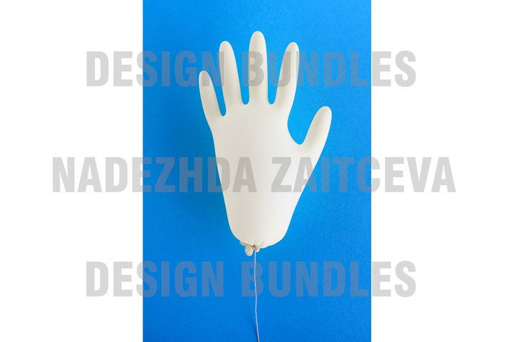 Disposable medical glove on blue background.