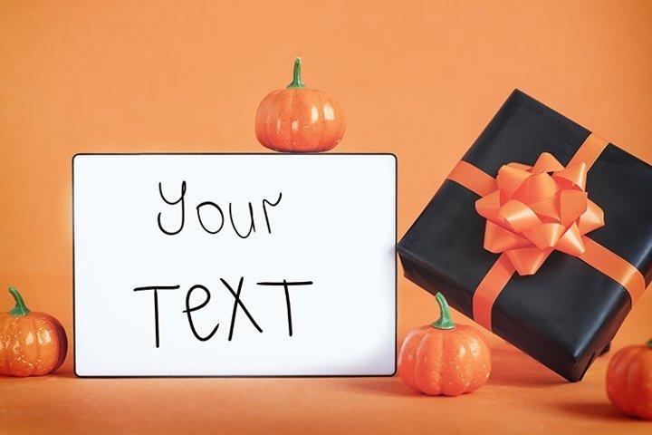Empty blank lightbox on orange background with black present
