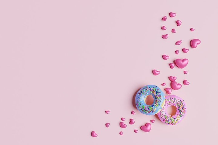 Valentines day mockup. Pink hearts and glazed donuts.