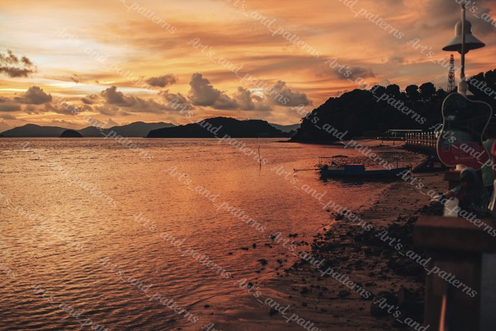 Beautiful red sunset with clouds on the beach of Phuket. Sea