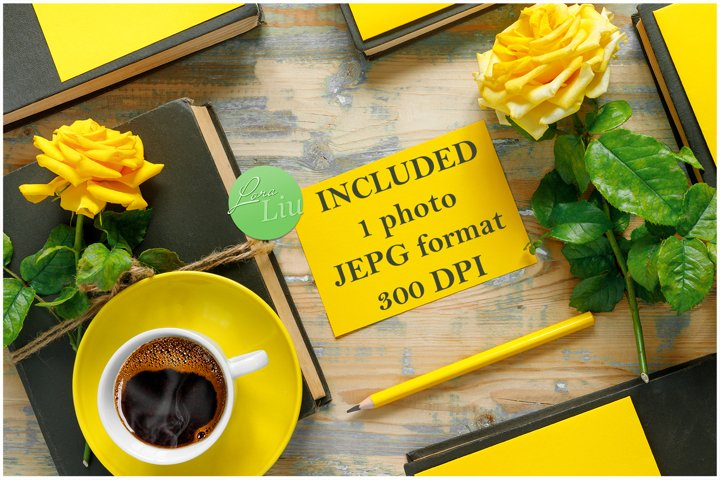 Yellow roses, vintage books and hot coffee