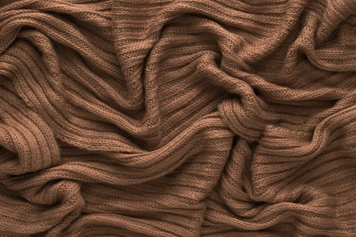 Crumpled knitted brown texture background.