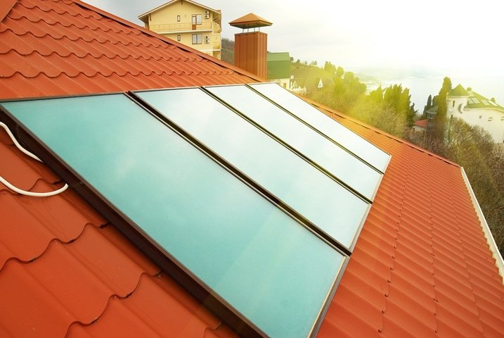 Solar water heating system geliosystem on the red house roof