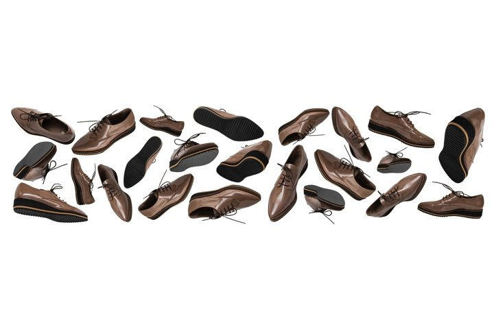 Set of flying brown patent leather women shoes. Banner