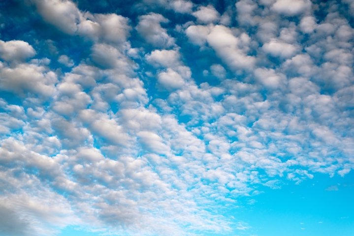 Blue sky background with white clouds. Beautiful cloud scape
