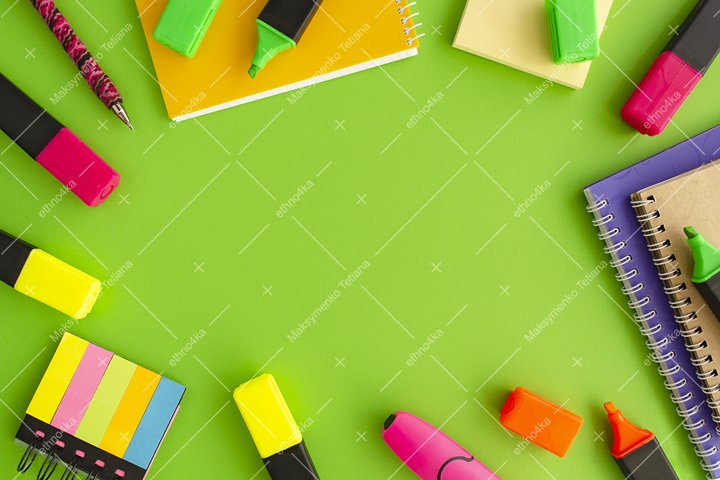Decorative frame of stationery on green background flat lay