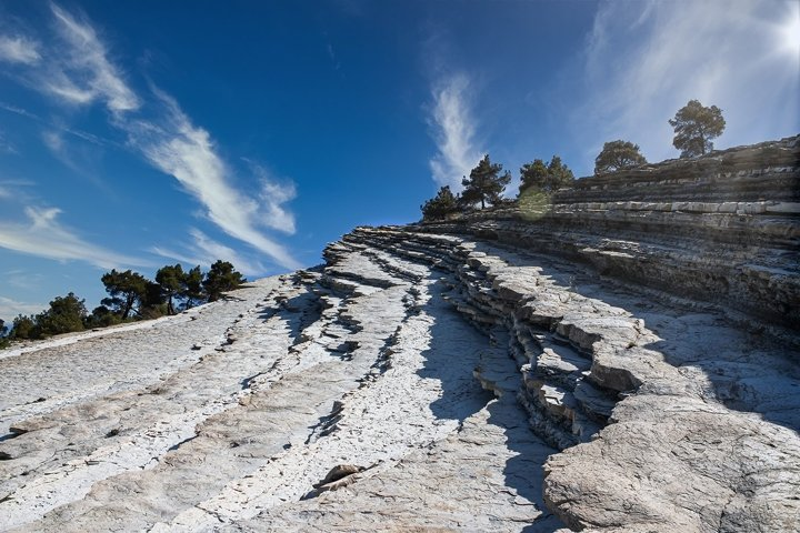 The top of the cliff against the blue sky with clouds. 2pcs