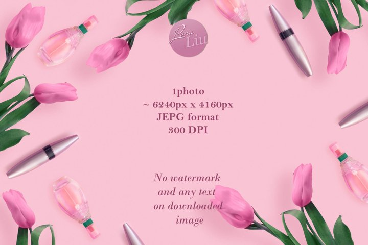 Beautiful pink tulips with cosmetics on pink background