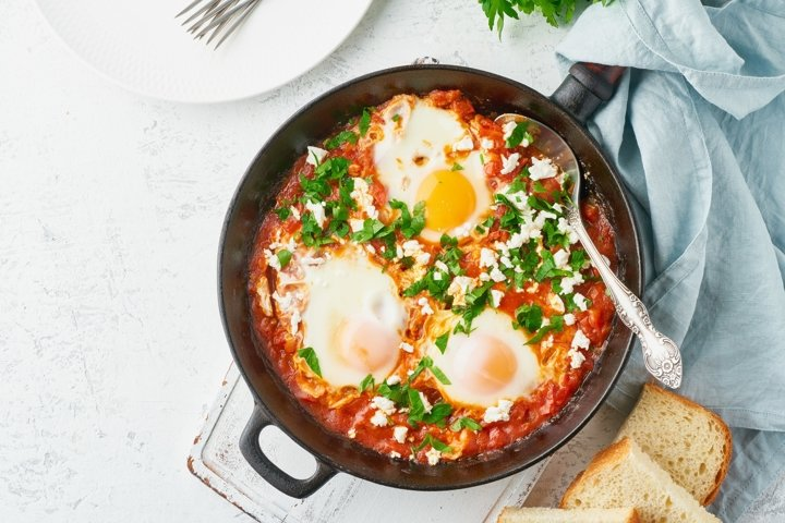 Shakshouka, eggs poached in sauce of tomatoes