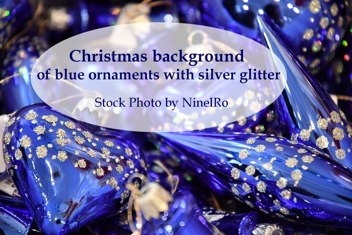 Christmas background of blue ornaments with silver glitter