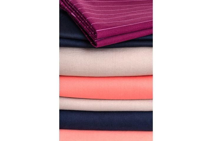 Stack of neatly folded clean colored linens. Background