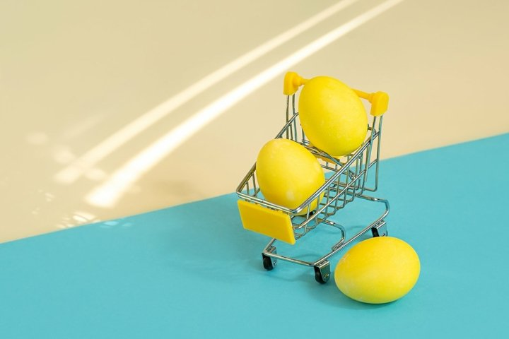 Yellow easter eggs in supermarket trolley