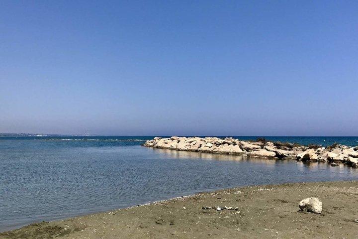 rocks and blue sea on the beach in larnaka cyprus