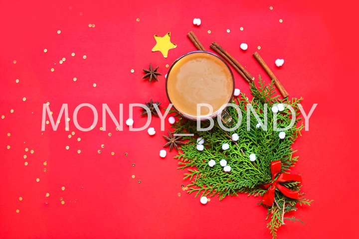 Cup of coffee with milk christmas decor red background