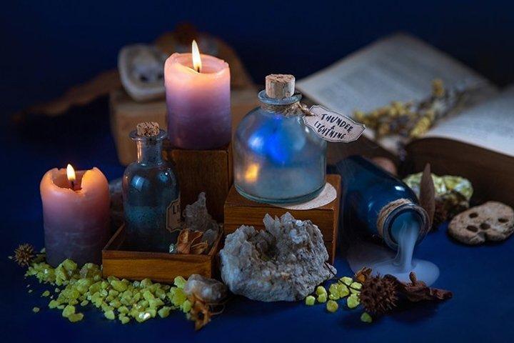 Night fabulous still life. Lab wizard. Flasks, candles,magic