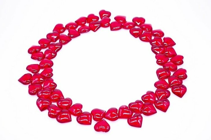 Round frame made of red hearts