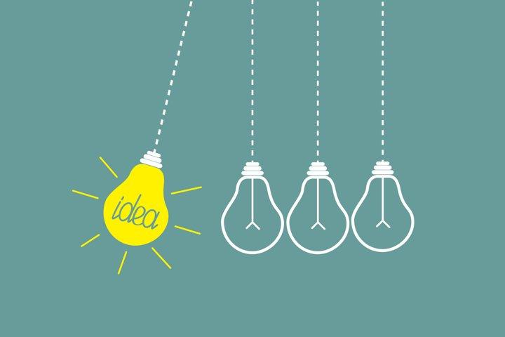 Four hanging yellow light bulbs.