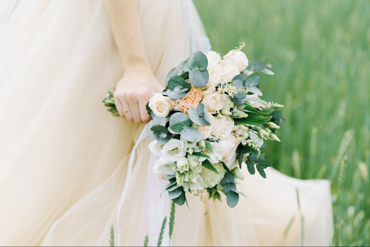 Beautiful bouquet disheveled in the hands of the bride
