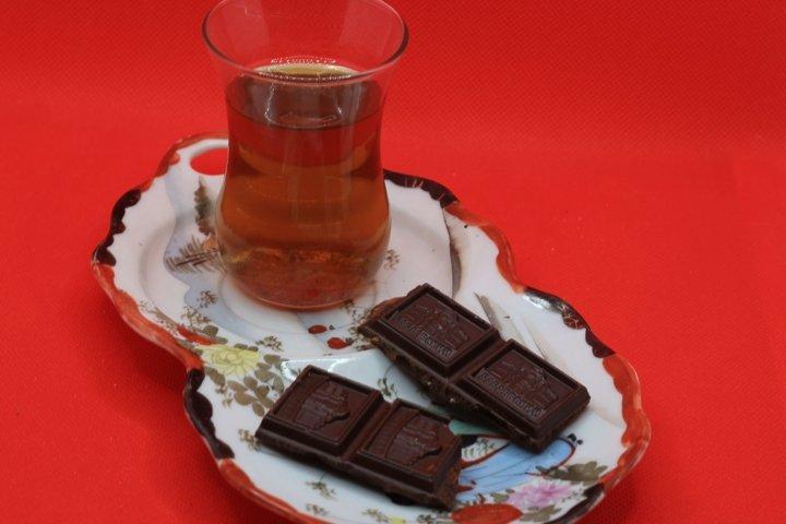tea and chocolate on a saucer