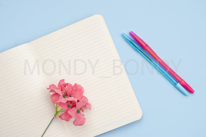 White open notebook for notes, white cup of coffee with milk