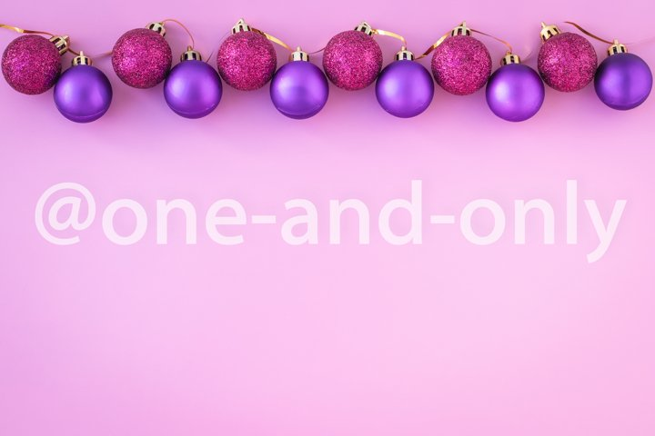 Christmas balls on pink background. Mockup with copy space.