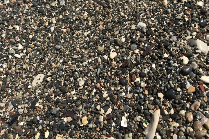 background of sea stones on the beach