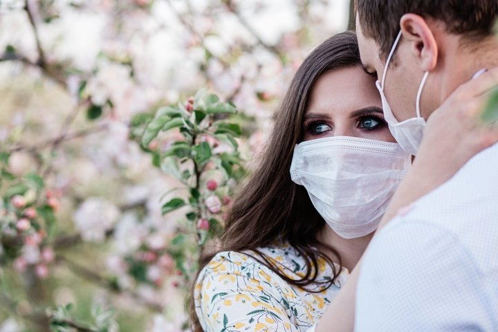 lovely young couple wearing masks during a pondemic, virus