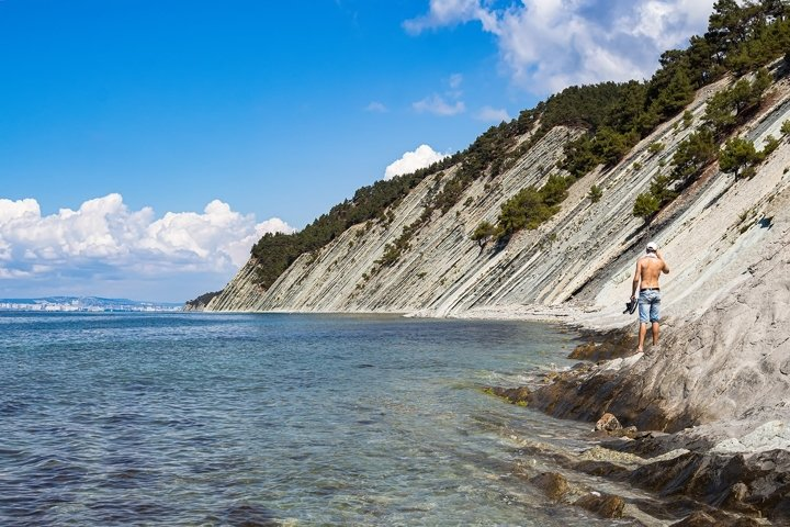 Picturesque stone wild beach at the foot of the rocks. 2pcs