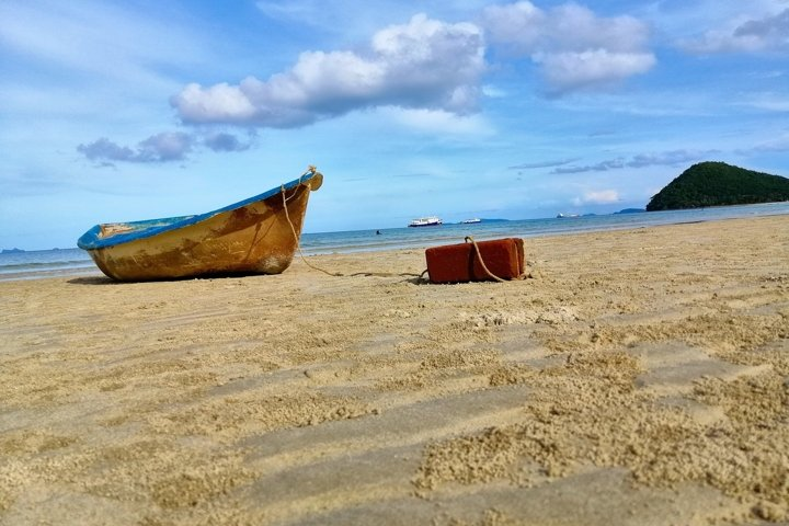 Wooden fishing boat on a sandy beach