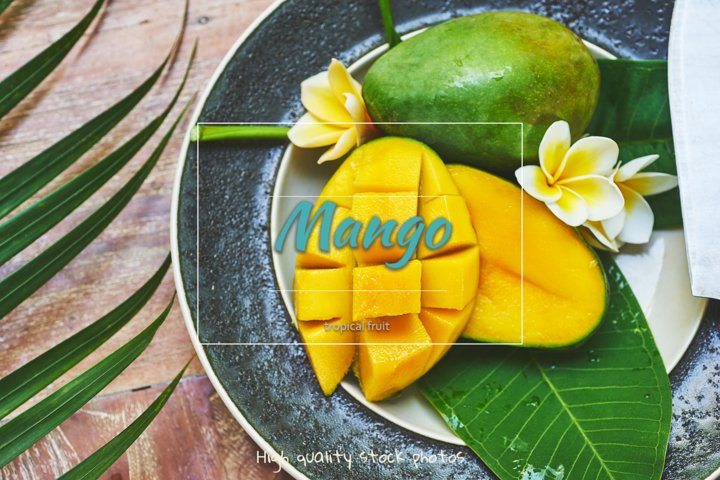 Mango on a beautiful plate with tropical leaves and flowers
