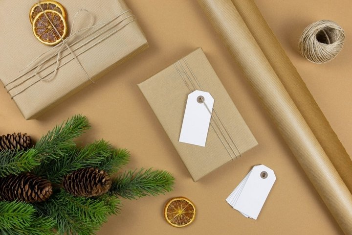 Christmas decoration wrapped gift with label. Flat Lay.