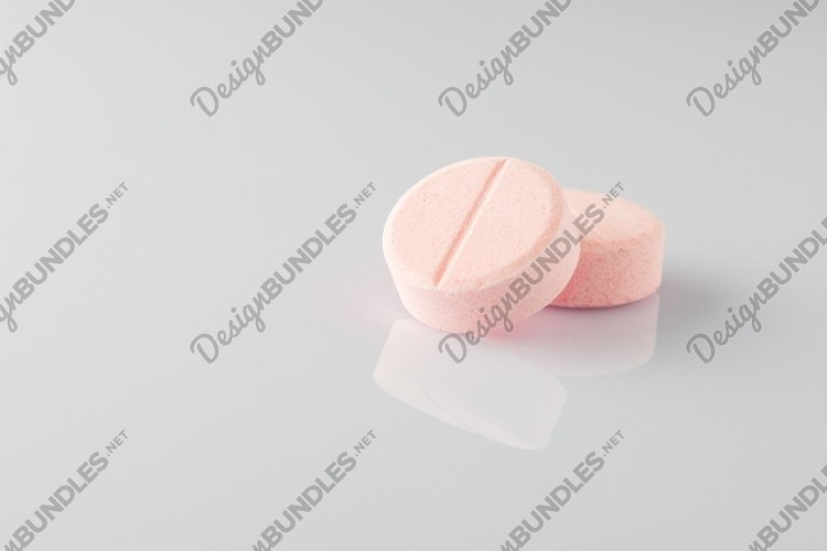Tablets on a light surface example image 1