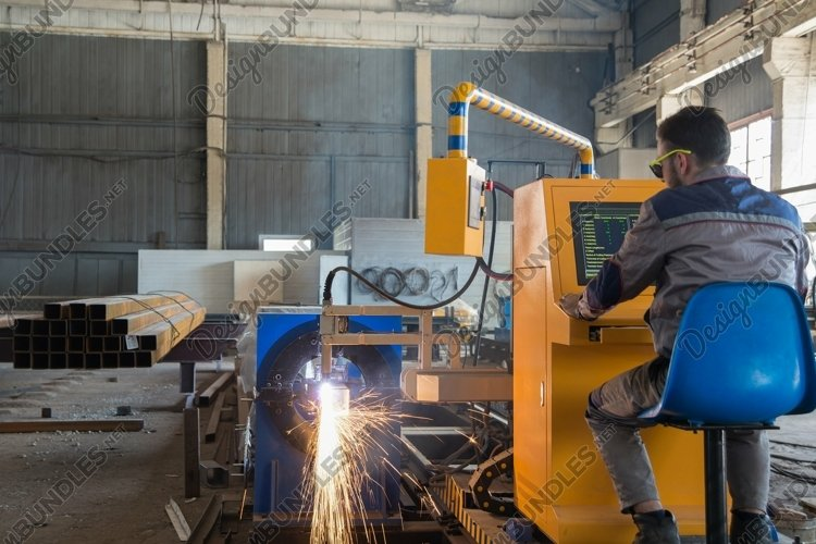 Worker behind a remote control gas welding machine example image 1