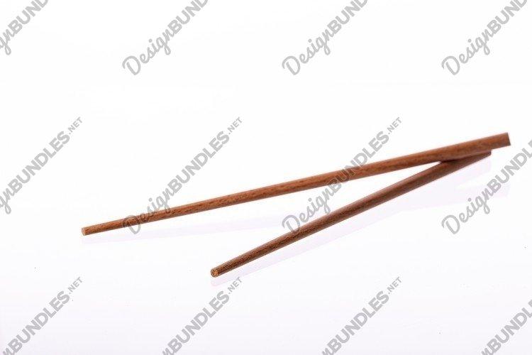 Eco-friendly wooden chopsticks isolated on white background example image 1