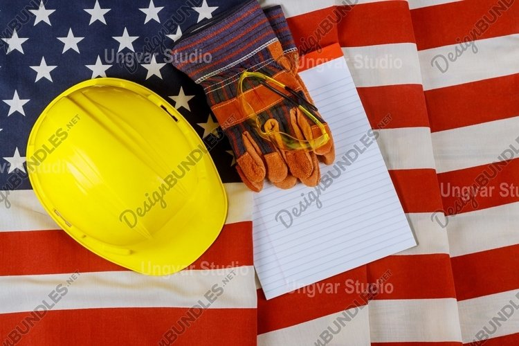 Happy labor day in the yellow hard hat construction helmet