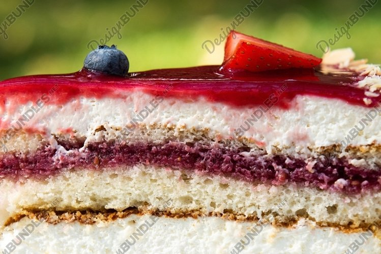Slice cheesecake with strawberry and blueberries
