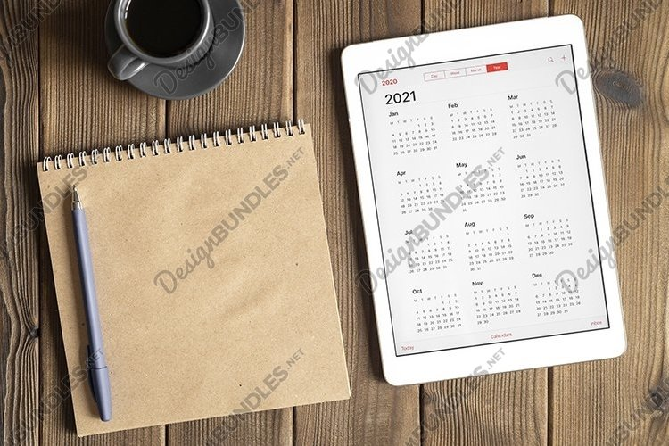 tablet with calendar for 2021, coffee, notebook, copy space example image 1