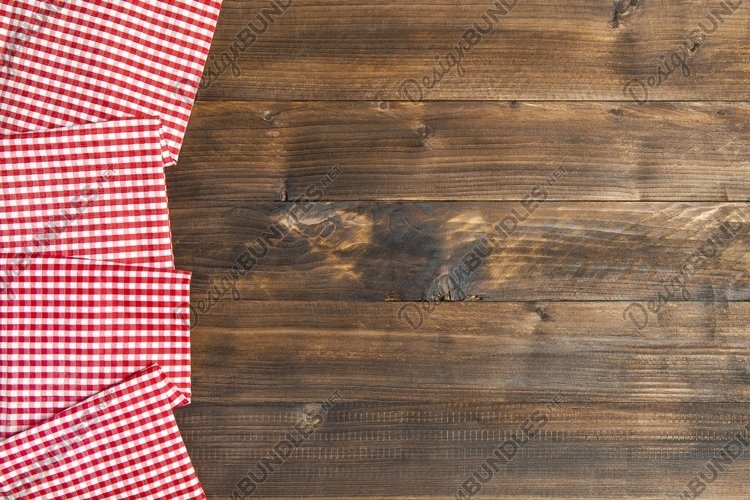 Wooden kitchen table background and chequered tablecloth example image 1