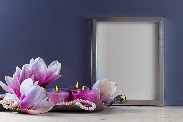 Gray room interior decor with fresh magnolia flowers example image 1