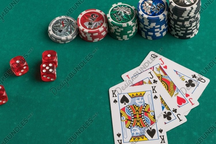 Poker chips, cards and dice on a green. Casino and poker example image 1