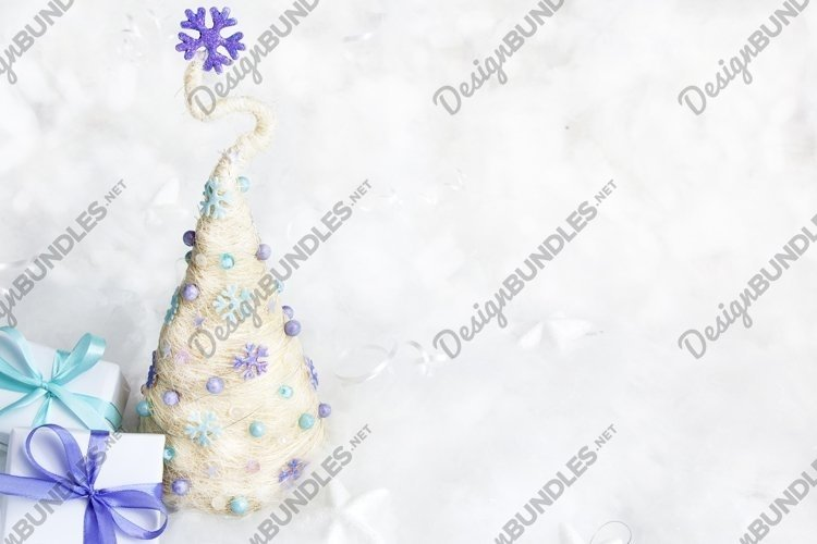Christmas tree with gifts in snow copy space