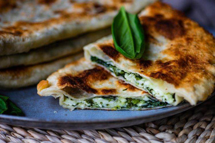 Traditional azerbaijan cuisine flat bread with herbs kutaby example image 1