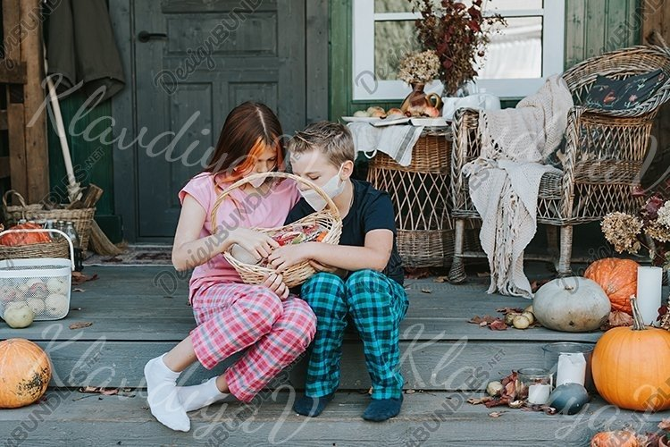 children a boy and a girl in pajamas and face mask example image 1