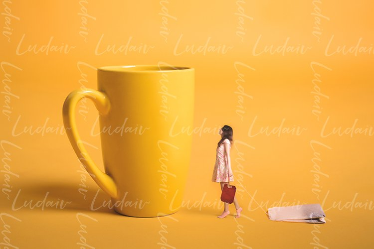 Surrealism design. Girl holding a tea bag in his hand.