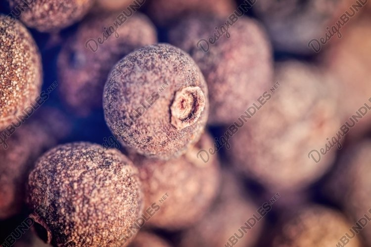 Red and black allspice on the background of a wooden table example image 1