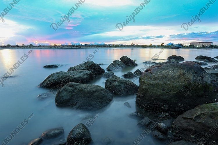 Long exposure of sea and rocks example image 1