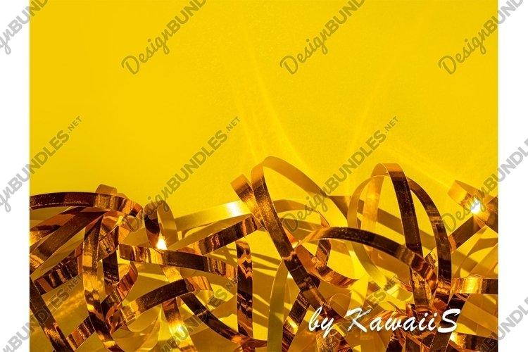 Festive yellow background Golden shiny ribbons texture example image 1