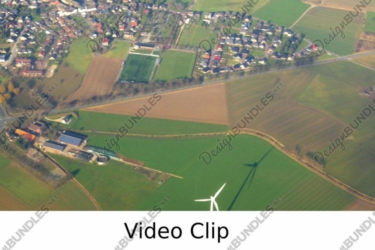 Video: Aerial view to the green fields and small town