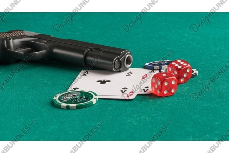Poker chips, cards and gun on a green. Casino and poker example image 1