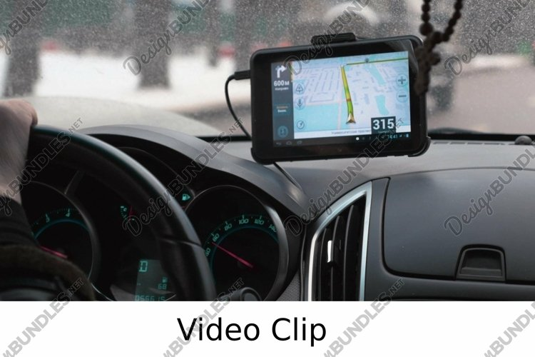 Video: Driving a car with GPS device over dashboard example image 1